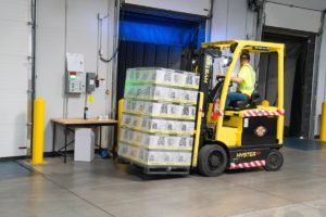 Forklift lifting pallets.